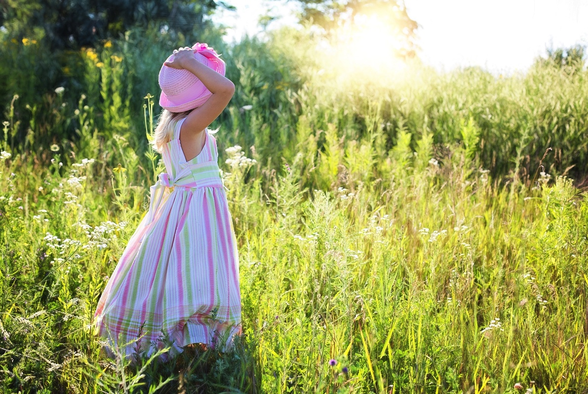 Girl looking at the field of flowers
