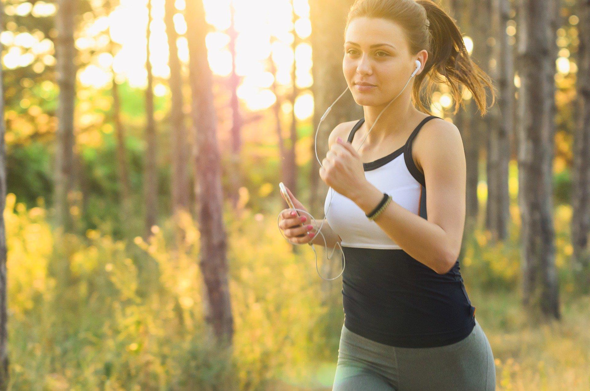 Girl running through the forest